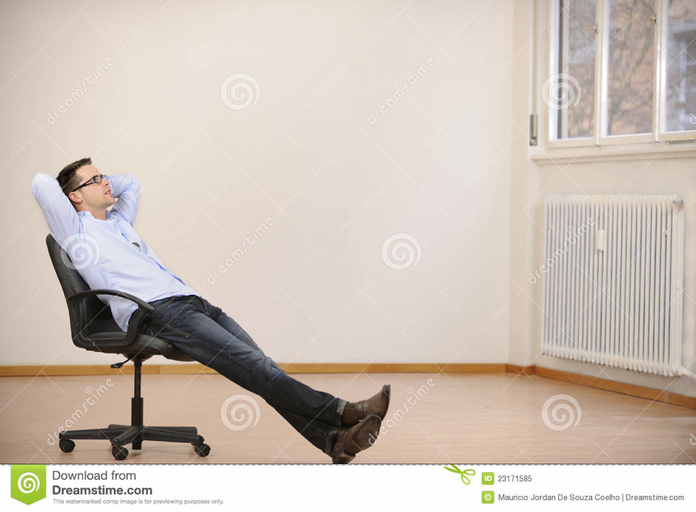 businessman-sitting-alone-new-new-office-23171585