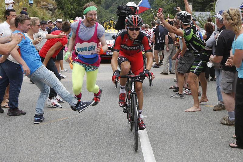 Man-Trips-Tour-De-France-Runner-Into-a-Faceplant
